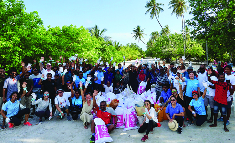 The Conrad embarks on plastic run with island locals and hotel staff. | Photos by Don Dao