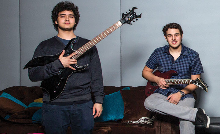 Mohammed Hakeem on bass. (Right) Salah Al Azhari , rhythm guitarist. (Left)