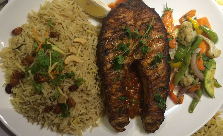 Salmon steak with mexican salsa served with grilled vegetables and biryani