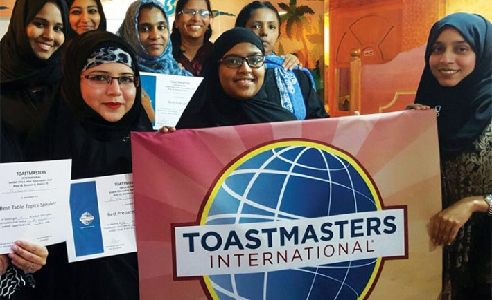 Jeddah-Elite-Ladies-Toastmasters-pose-with-their-club-banner-at-their-55th-meeting