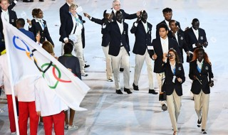 The Refugee Olympic team members take part in the opening ceremony of the Rio 2016 Olympic Games at the Maracana stadium in Rio de Janeiro on August 5, 2016