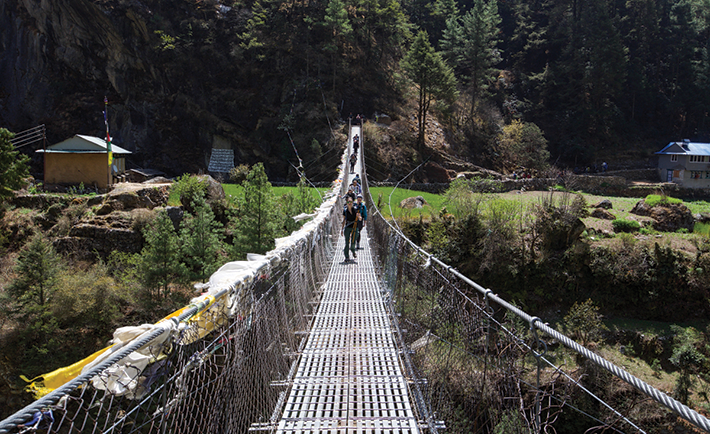Crossing a bridge in Nepal during emergency medicine training.