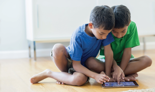 boys-using-digital-tablet-on-floor-187138181-58b522e75f9b586046eca157
