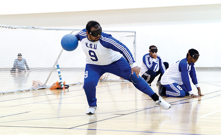 Goal ball is a sport for the visually impaired using a ball fitted with bells. The Saudi Goal Ball team is the first in the gulf and has won 8 championships.