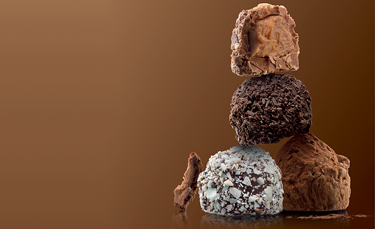 stacked-truffles-on-brown-background