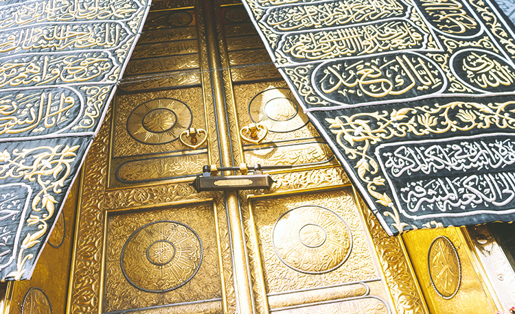 MECCA, SAUDI ARABIA - MAY 01 2018: The golden doors of the Holy Kaaba closeup, covered with Kiswah. Massive lock on the doors. Entrance to the Kaaba in Masjid al Haram; Shutterstock ID 1087638440; Purchase Order: -