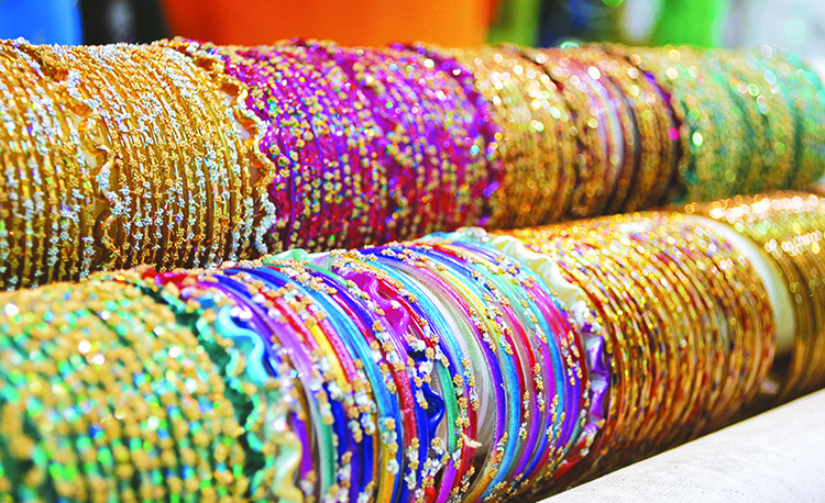 Enjoy the purchase of colorful jewelry from the Afghan market